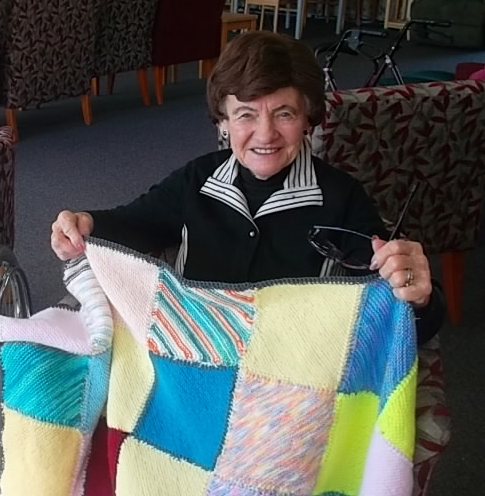 Lady with knitted blanket